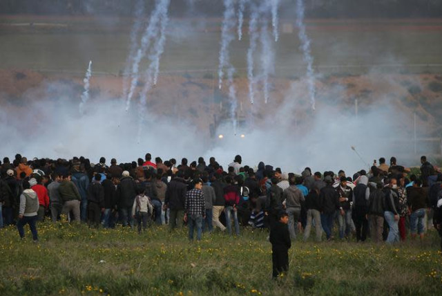 Tear gas canisters are fired by Israeli troops toward Palestinians during a protest at the Israel-Gaza border fence, in the southern Gaza Strip February 22, 2019