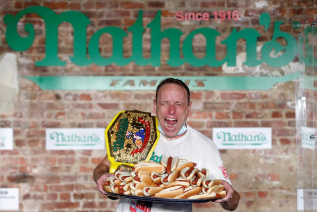 Joey Chestnut poses after winning the Nathan's Famous Fourth of July International Hot Dog Eating Contest with a world record 75 hot dogs consumed in Brooklyn, in New York City, U.S., July 4, 2020