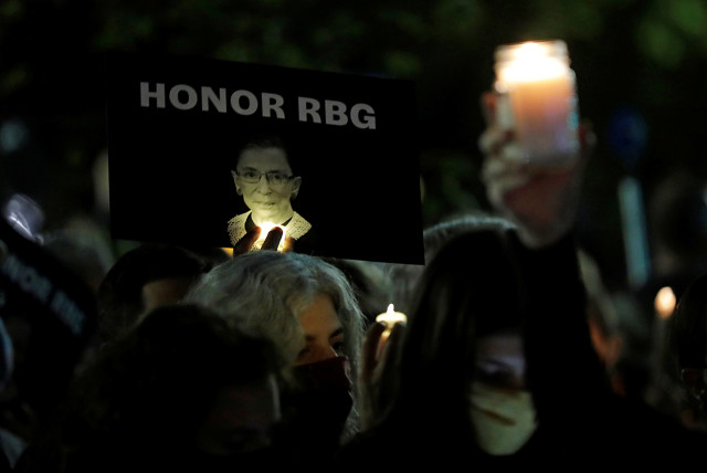 A sign with an image of late U.S. Supreme Court Justice Ruth Bader Ginsburg is displayed during a vigil following her death, outside the U.S. Supreme Court in Washington, U.S., September 19, 2020