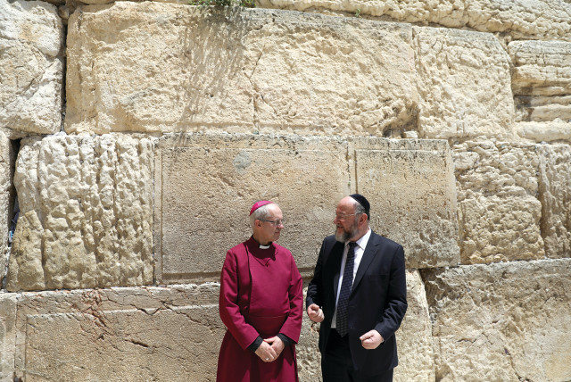 Archbishop of Canterbury Justin Welby and Britain's Chief Rabbi Ephraim Mirvis visit the Western Wall on May 3, 2017