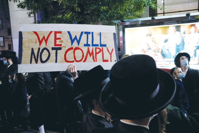 Ultra-Orthodox Jews gather in the Borough Park neighborhood of Brooklyn to protest against coronavirus restrictions, in October.