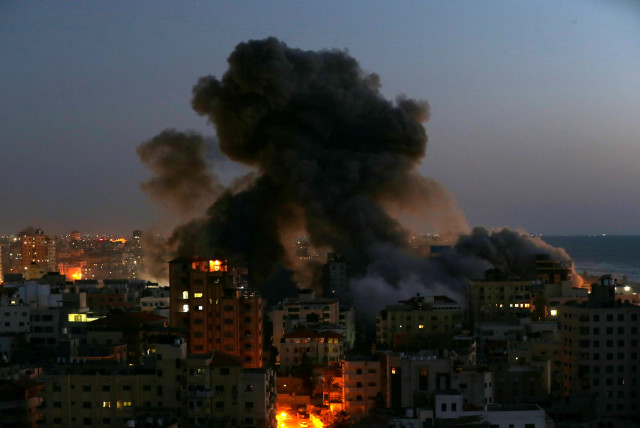 Smoke rises from a building after it was destroyed by Israeli air strikes amid a flare-up of Israeli-Palestinian violence, in Gaza May 11, 2021