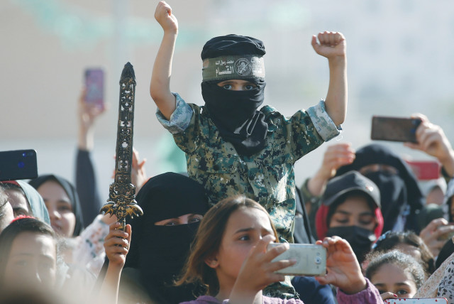 HAMAS SUPPORTERS attend an anti-Israel rally in the northern Gaza Strip on Sunday.