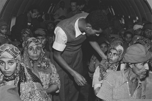 YEMENITE JEWS are seen on a plane traveling to Lod airport as part of Operation Magic Carpet in 1949
