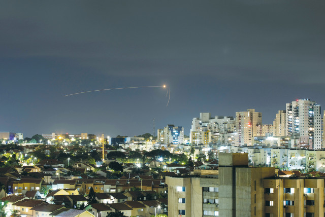 STREAKS OF LIGHT are seen from Ashkelon as the Iron Dome intercepts a rocke launched from the Gaza Strip on September 11.