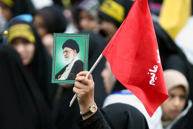 An Iranian protester holds the picture of Iranian Supreme Leader Ayatollah Ali Khamenei as she attends an anti US demonstration, marking the 40th anniversary of the US embassy takeover, near the old US embassy in Tehran, Iran, November 4, 2019.
