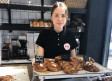 Michaela Borg stands behind the counter of the Swedish bakery Fika in Tel Aviv