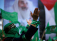 A Palestinian woman takes part in a rally marking the 30th anniversary of Hamas in Gaza