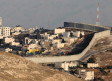 A security fence separates the Arab village of Abu Dis from east Jerusalem