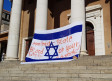 A bloodied Israeli flag hangs on the main building at the University of Cape Town on Monday.