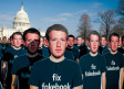 DOZENS OF cardboard cutouts of Facebook CEO Mark Zuckerberg are seen during a protest outside the US