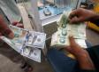 Iranian rials, U.S. dollars and Iraqi dinars at a currency exchange shop in Basra, Iraq, November 3,