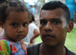 Ivan Carranza, 24, with his daughter, Maikelis, immigrants from Venezuela