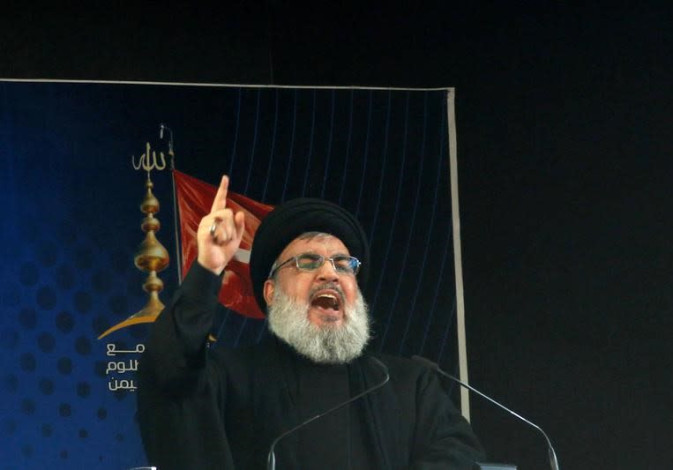 Hezbollah leader Sayyed Hassan Nasrallah delivers a speech