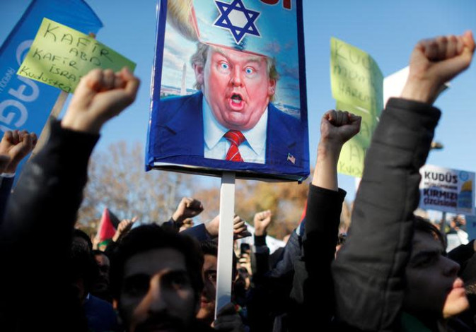Demonstrators shout slogans during a protest against U.S. President Donald Trump's recognition of Je