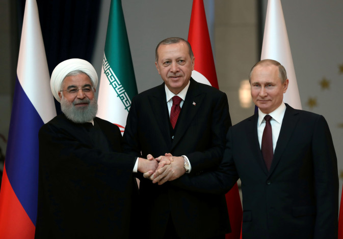Presidents Hassan Rouhani of Iran, Tayyip Erdogan of Turkey and Vladimir Putin of Russia pose before