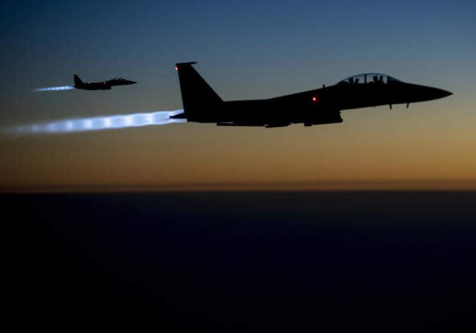 A pair of US Air Force F15E Strike Eagles fly over northern Iraq after conducting strikes in Syria