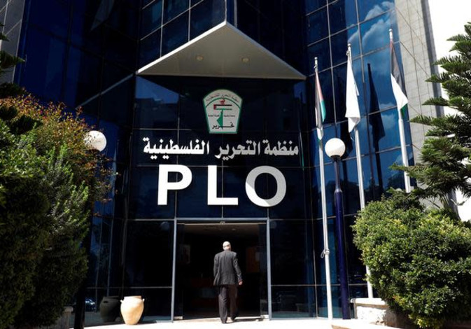 A man enters the headquarters of the Palestinian Liberation Organization (PLO), in Ramallah Septembe