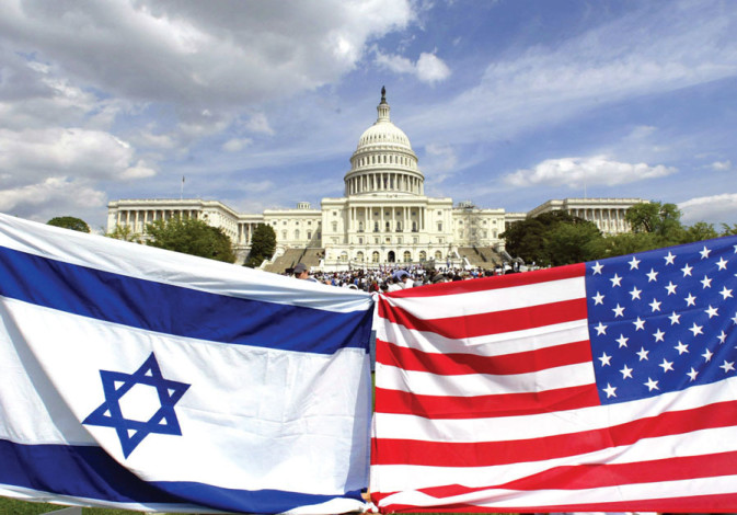 AMERICAN AND ISRAELI flags fly during a demonstration in support of Israel at the US Capitol in 2002