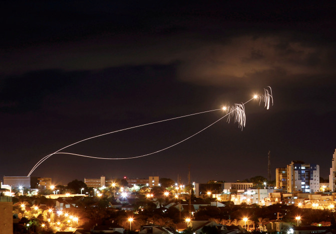Iron Dome anti-missile system fires interception missiles as rockets are launched from Gaza