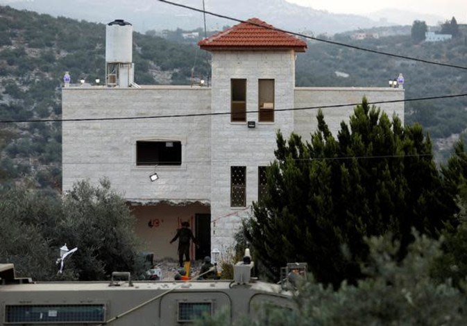 Israeli forces destroy part of the family house of Palestinian guman Ashraf Naalwa