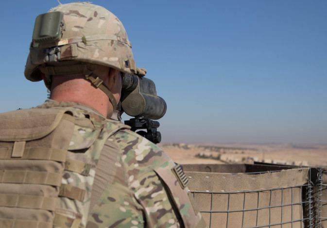 A U.S. Soldier surveils the area during a combined joint patrol in Manbij, Syria, November 1, 2018.