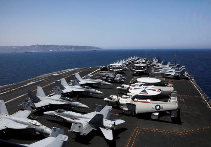 A general view shows the dock of the U.S. aircraft carrier USS George H. W. Bush, as it docks at Hai