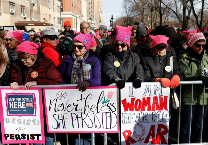 People line Central Park West as they participate in the Women's March in Manhattan, New York City.