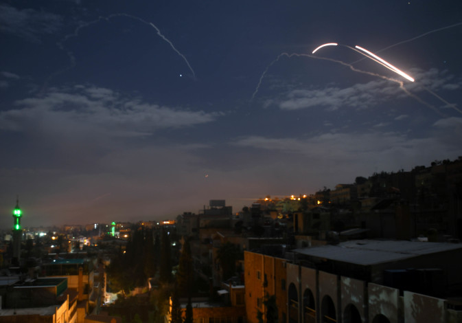 Syrian air defence batteries responding to what the Syrian state media said were Israeli missiles