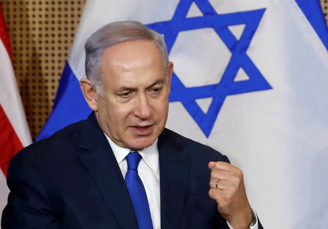 Israeli Prime Minister Benjamin Netanyahu speaks as he meets with U.S. Vice President Mike Pence