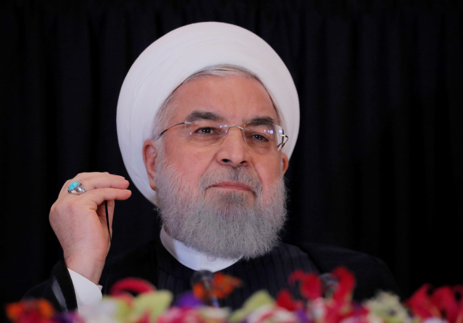 Iran's President Hassan Rouhani listens during a news conference on the sidelines of the 73rd sessio