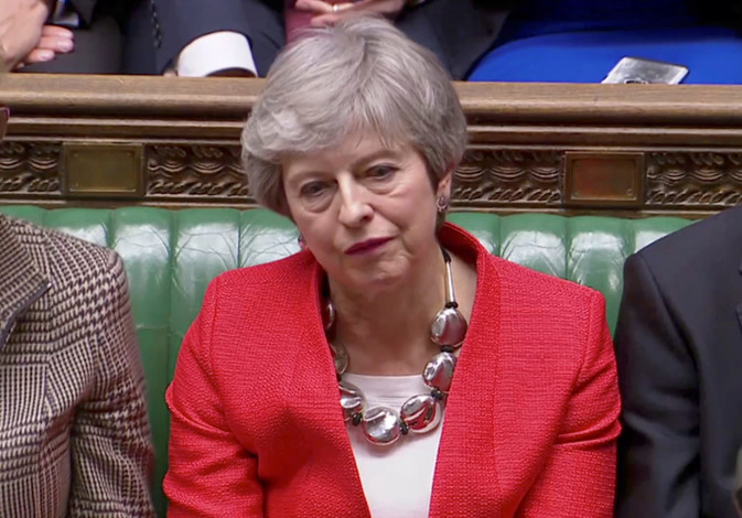 British Prime Minister Theresa May reacts after tellers announced the results of the vote Brexit dea