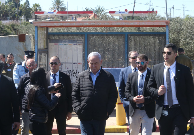 Prme Minister Benjamin Netanyahu at the terror attack site in Ariel in the West Bank on March 18, 20