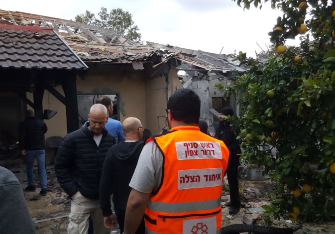 A house is taken care of by the Fire Department after being hit by rocket fire coming from Gaza.