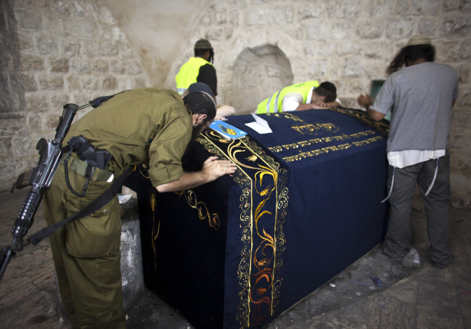 An Israeli soldier prays together with other worshippers inside Joseph's Tomb in the West Bank