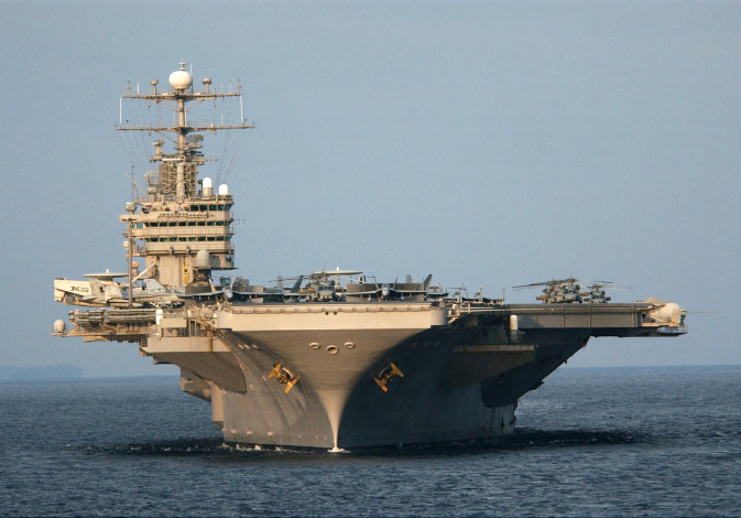 The aircraft carrier USS Abraham Lincoln (CVN 72) sails in the Indian Ocean near Indonesia, February
