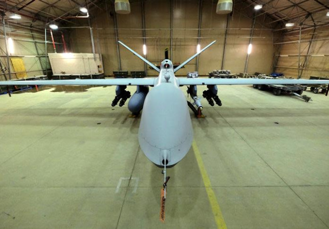 A U.S. Air Force MQ-9 Reaper drone sits armed with Hellfire missiles and a 500-pound bomb