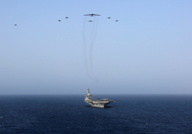 United States aircraft carrier Abraham Lincoln (CVN 72) and a U.S. Air Force B-52H Stratofortress, d