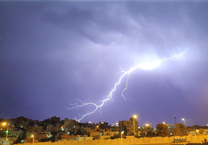 Lightning strikes over the Beit Safafa neighborhood in Jerusalem, Oct. 14, 2019