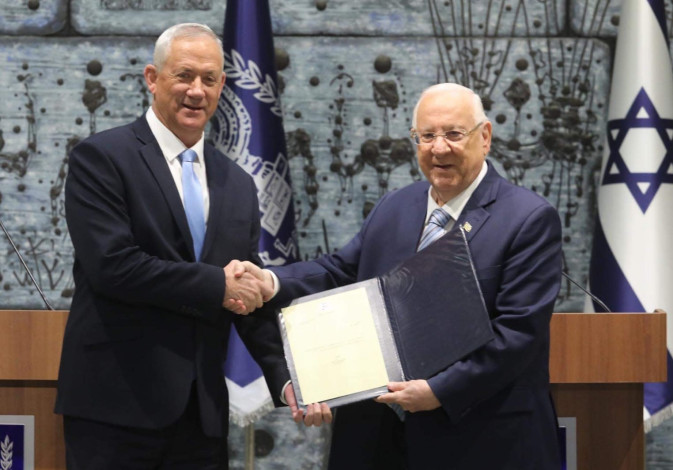 Blue and White leader Benny Gantz (L) receives the mandate to form a government from President Reuve