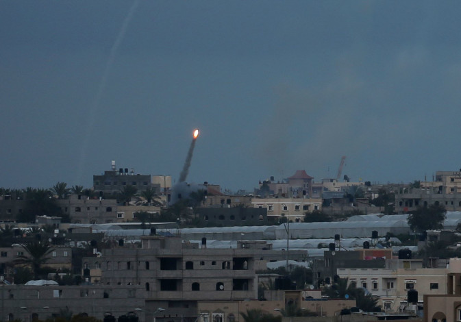 A rocket is fired towards Israel, in the southern Gaza Strip February 24, 2020