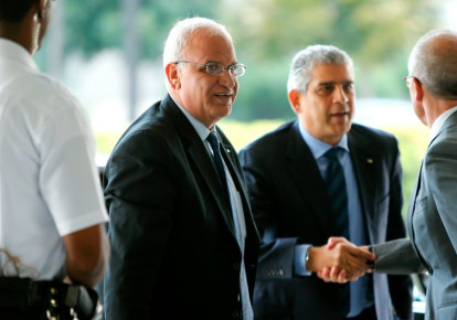 Palestinian Chief Negotiator Saeb Erekat (C) and Maen Rashid Areikat (2nd R), chief of the PLO)delegation in Washington, arrive to meet with US Secretary of State John Kerry in Washington September 3, 2014. (photo credit: REUTERS)