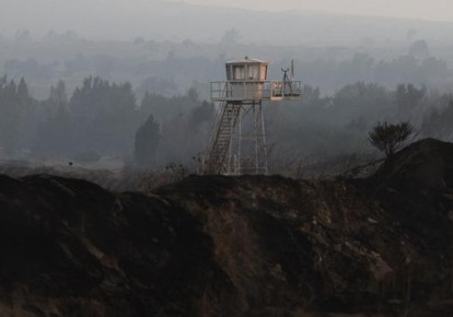 A UN observation tower is seen overlooking Syria, next to the Quneitra border crossing between the Golan Heights in Israel and Syria. (photo credit: REUTERS)
