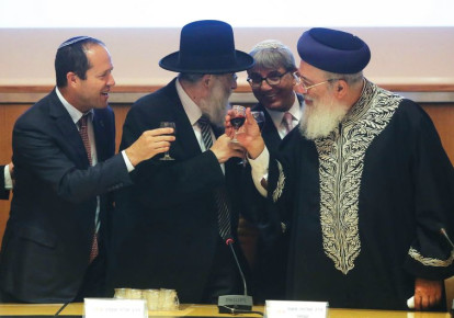 Mayor Nir Barkat shares a toast with chief rabbis Arye Stern and Shlomo Amar. (photo credit: MARC ISRAEL SELLEM/THE JERUSALEM POST)