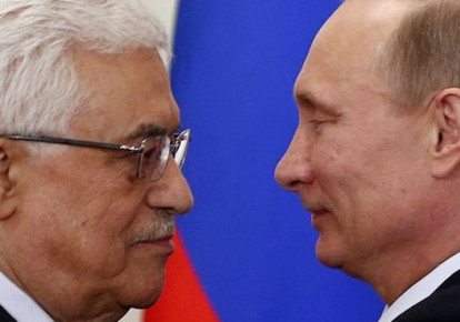 Russian President Vladimir Putin (R) and Palestinian Authority chief Mahmoud Abbas in Moscow (photo credit: REUTERS)