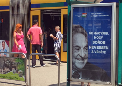 "Hungarian government poster portraying financier George Soros and saying ""Don't let George Soros have the last laugh"" is seen at a tram stop in Budapest, Hungary (photo credit: REUTERS/KRISZTINA THAN)"
