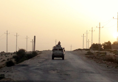 An Egyptian military vehicle is seen on the highway in northern Sinai, Egypt, May 25, 2015. (photo credit: ASMAA WAGUIH / REUTERS)