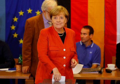 German Chancellor and leader of the Christian Democratic Union CDU Angela Merkel votes in the general election (Bundestagswahl) in Berlin, Germany, September 24, 2017. (photo credit: REUTERS/KAI PFAFFENBACH)