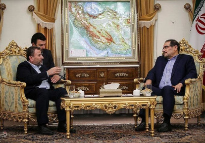 Saleh al-Arouri (L), Hamas deputy chief, meets with Ali Shamkhani, secretary of Iran's National Security Council, in Tehran, Iran October 21, 2017.  (photo credit: TASNIM NEWS AGENCY/HANDOUT VIA REUTERS)