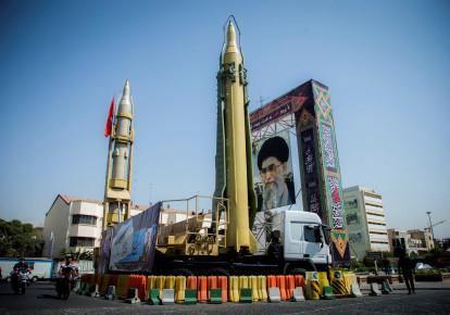 Missiles and a portrait of Iran's Supreme Leader Ayatollah Ali Khamenei in Baharestan Square in Tehran, Iran (photo credit: NAZANIN TABATABAEE YAZDI/ TIMA VIA REUTERS)